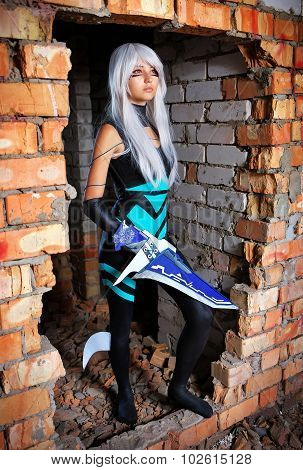 Young Girl Holding A Blade In The Dungeon Original Cosplay Character. Artistic Shoot, New Conceptual