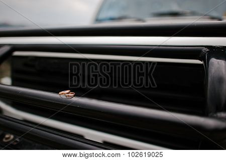 Wedding Ring On The Bumper Of Car