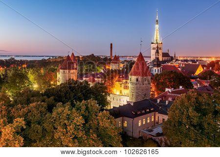 Old Tallinn, City Walls, Towers, Churches And Bay Of Tallinn By Night