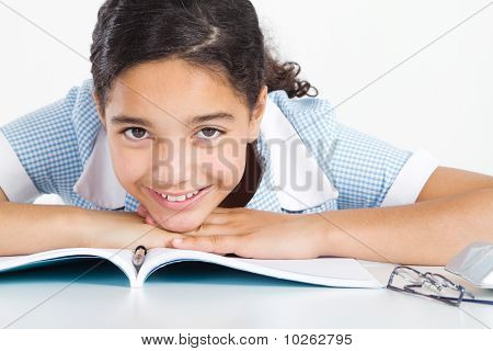 young student relaxing at school desk