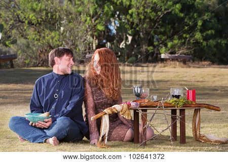 Happy Pagan Couple At Altar