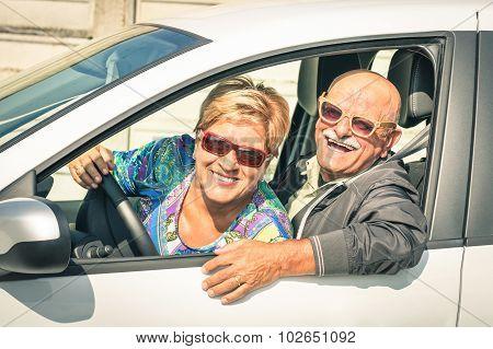 Happy Senior Couple Ready For Driving A Car On A Journey Trip - Joyful Active Elderly Lifestyle