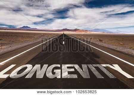 Longevity written on desert road