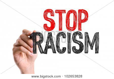 Hand with marker writing: Stop Racism