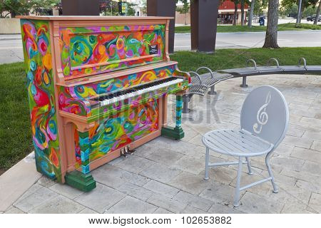 FORT COLLINS, CO, USA, JULY 17, 2012: One of pianos painted within Pianos About Town program,  artist - Diane Findley, old town of Fort Collins.