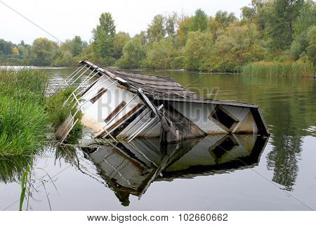 House Drowning In The River. The Concept  Agency Real Estate Insurance.