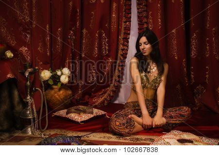Oriental Woman In A Traditional Costume
