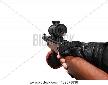 Hand holding automatic gun.