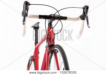 Sport Concept. Professional Road Bicycke With Red Carbon Frame. Against White