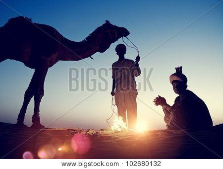 Two Indigenous Indian Men Resting Camel Concept