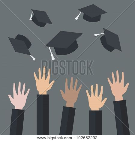 Hands Of Graduates Throwing Graduation Hats In The Air