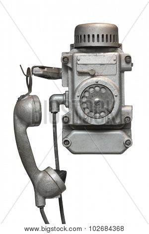 Vintage metal disk phone for heavy operating conditions.Isolated on white .