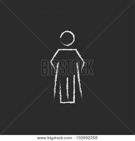 Man with crutches hand drawn in chalk on a blackboard vector white icon isolated on a black background.