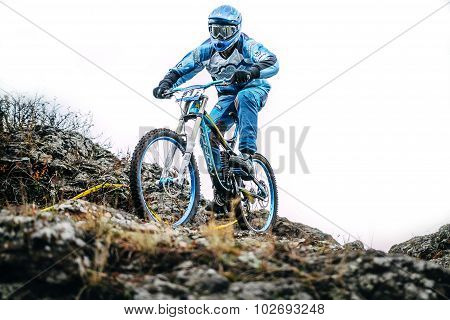 mountainbiker riding a Bicycle on the edge of the cliff