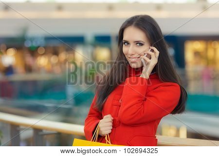 Shopping Mall Girl in a Red Coat Talking on Smartphone