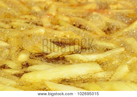 French Fries Boiling In Hot Oil - Shallow Doff
