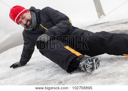 Man Has An Accident On A Icy Street