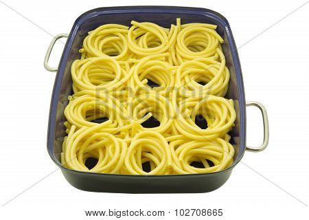 Macaroni noodles in a roaster on white background