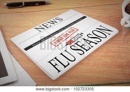 newspaper with flu headline against overhead of office desk