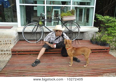 Asia Thailand Man Cowboy Sit With Dog