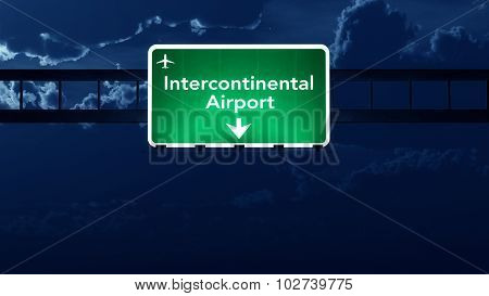 Intercontinental Airport Highway Road Sign At Night