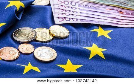 Euro coins. Euro currency. Euro money. European flag and euro money.