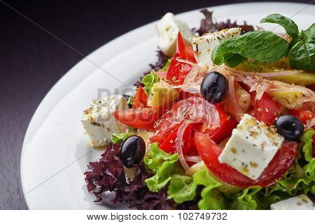 Closeup of vegetable salad on white plate