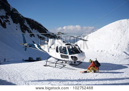 White rescue helicopter parked in the snowy mountains poster