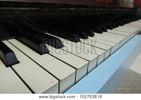 Piano aka Pianoforte keyboard perspective close up