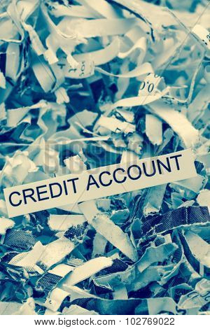papierschnitzel tagged with credit account, symbolfoto for data destruction, finance and credit