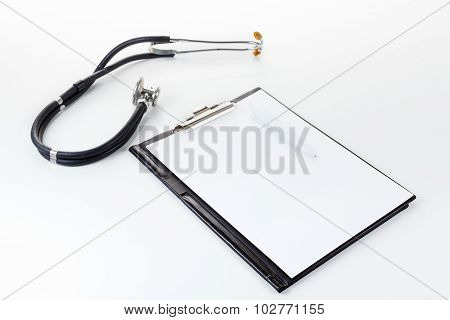 Medical Stetoscope On The Light Surface