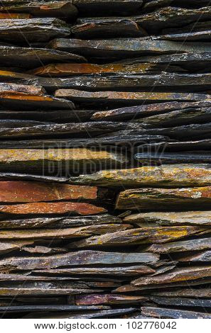 Background detail of rural house with piled schist stone blades