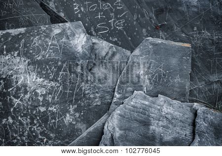 Rustic background of decorative black schist blades
