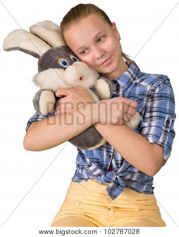 Teen girl embracing the plush toy hare poster