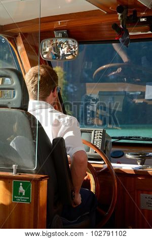 Unidentified Man At Boat's Steering Wheel