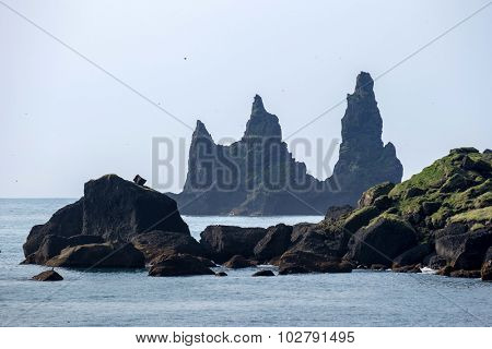 Wide view of Reynisdrangar rock formations on Reynisfjara Beach, Iceland