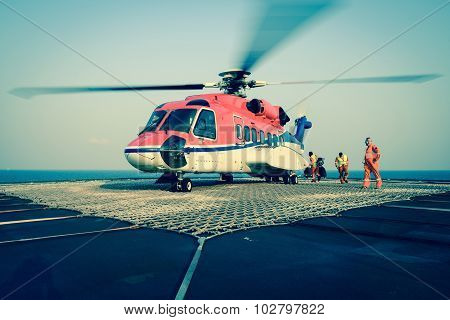 The Officer Take Care Passenger To Embark Helicopter At Oil Rig