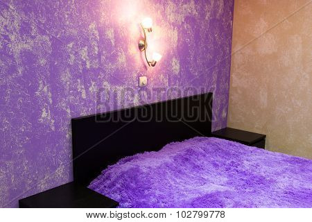 Bed In Bedroom In Shades Of Lilac