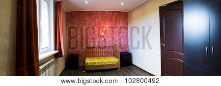 Cot In A Bedroom At The Red Wall
