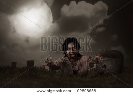 A Zombie rising from graveyard. Halloween concept poster