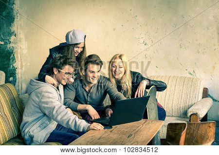 Group Of Young Hipster Best Friends With Computer Laptop In Urban Grunge Location
