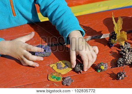 Child And Plasticine