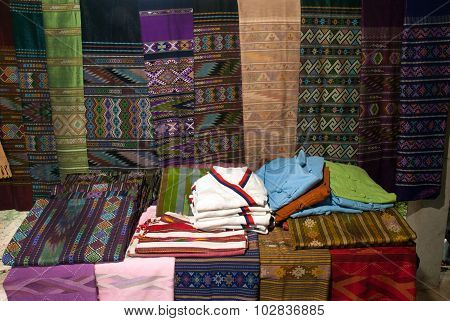 Traditional Clothes Lua Minority Show On Table And Hanging.