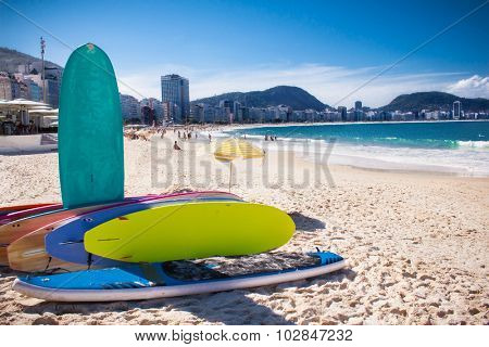 Surfboard and Brazilians at Copacabana Beach, Rio de Janeiro. Brazil.