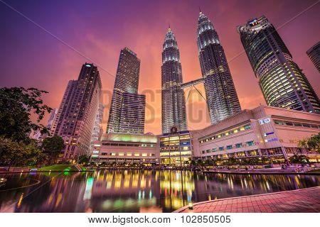 KUALA LUMPUR - SEPTEMBER 21, 2015: The Petronas Towers viewed from KLCC Park at twilight.