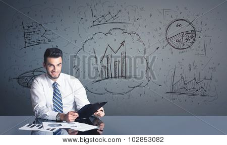 Successful businessman with all kind of hand-drawn business diagrams in background