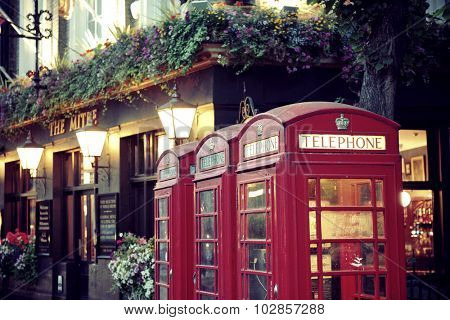 LONDON, UK - SEP 27: London Street view with telephone box on September 27, 2013 in London, UK. London is the world's most visited city and the capital of UK.