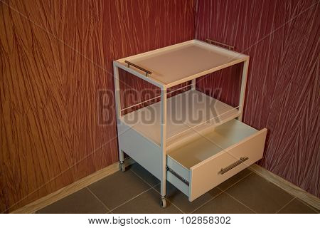 Medical trolley with opened box