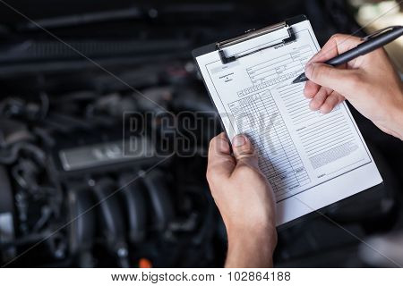 Mechanic Repairman Inspecting Car