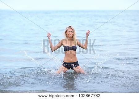 Beautiful woman sunbathing at the seaside outdoor poster